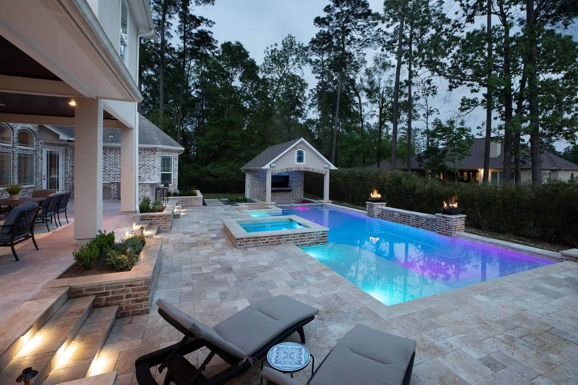 travertine patio, pool, spa and covered outdoor living space